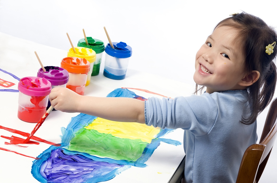 a toddler finger painting